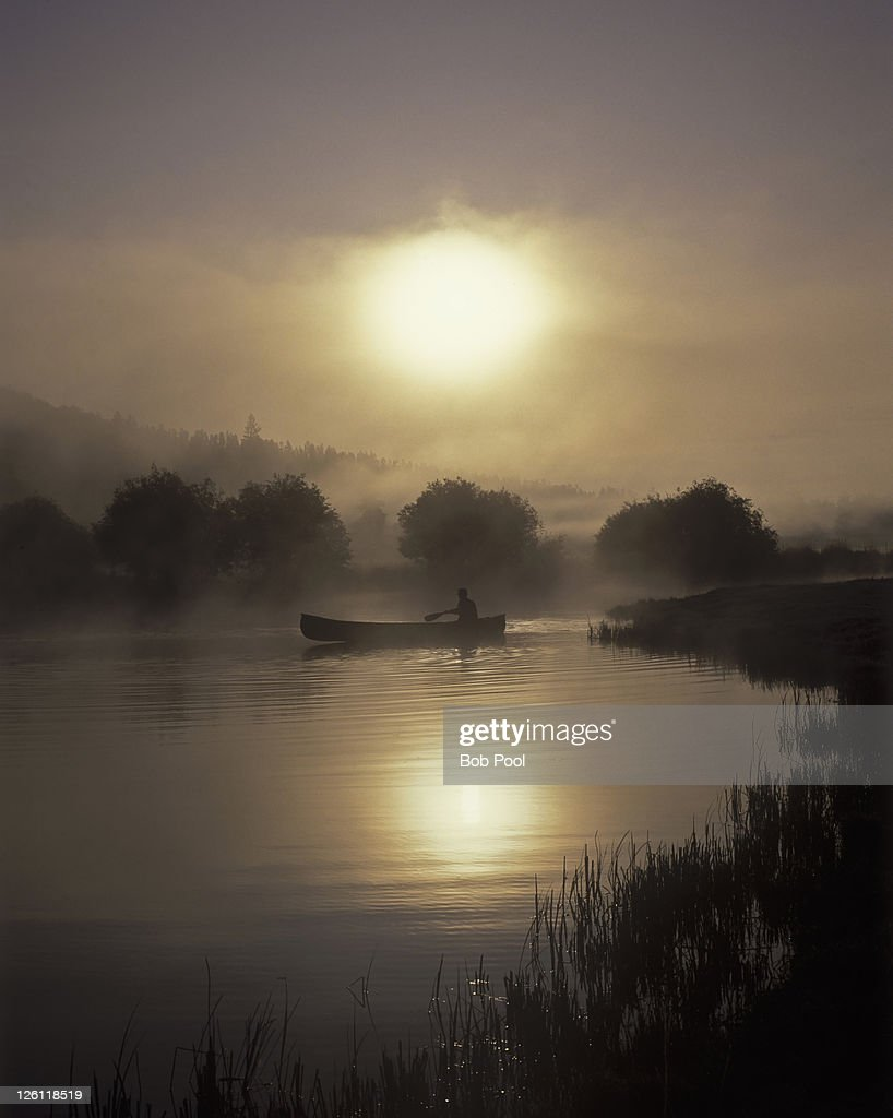 Canoe on foggy morning : Stock Photo