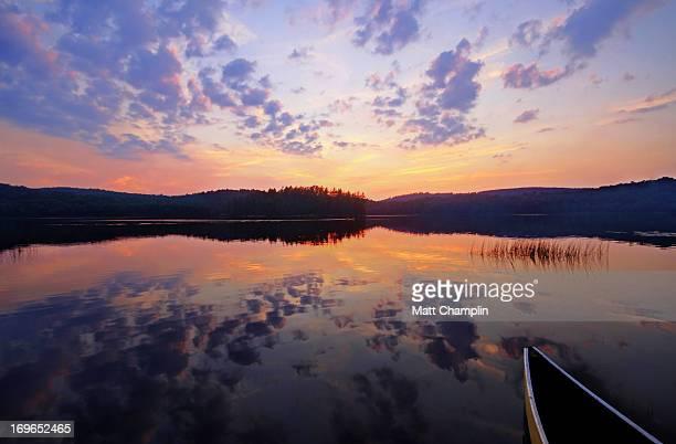 Canoe on Lake During Summer Sunset