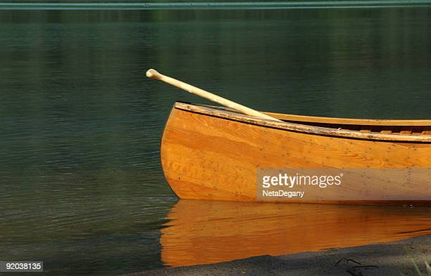 A canoe reflected on the surface of the water