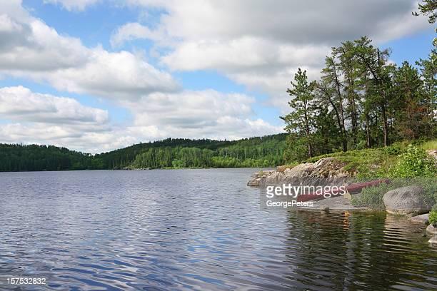 Canoe Resting on Wilderness Lake
