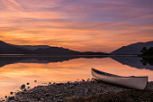 A canoe resting on Beach on Derwent Water in the English Lake District