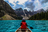 My fiance and I canoeing on the incredible turquoise water of Moraine Lake, in Banff National Park.