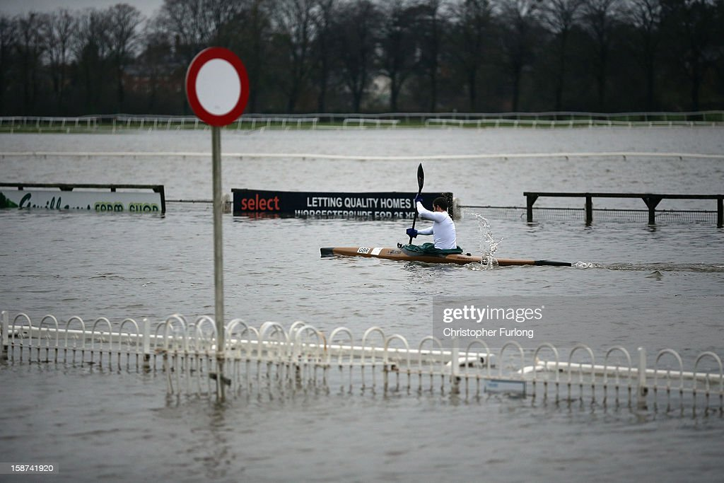 A canoeist paddles past the winning post on flooded Worcester racecourse on December 27, 2012 in Worcester, England. 2012 could be the wettest year on record according to forecasters and there are currently 88 flood warnings and 207 flood alerts in England and Wales. The Environment Agency in Hereford and Worcestershire are expecting further heavy rain, delaying a clean up until after the weekend.