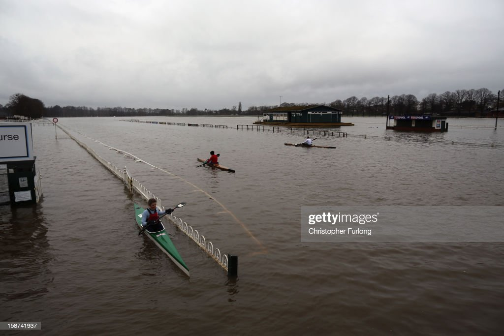 Canoeists paddle on the flooded Worcester racecourse on December 27, 2012 in Worcester, England. 2012 could be the UK's wettest year on record according to forecasters and there are currently 88 flood warnings and 207 flood alerts in England and Wales. The Environment Agency in Hereford and Worcestershire are expecting further heavy rain, delaying a clean up until after the weekend.