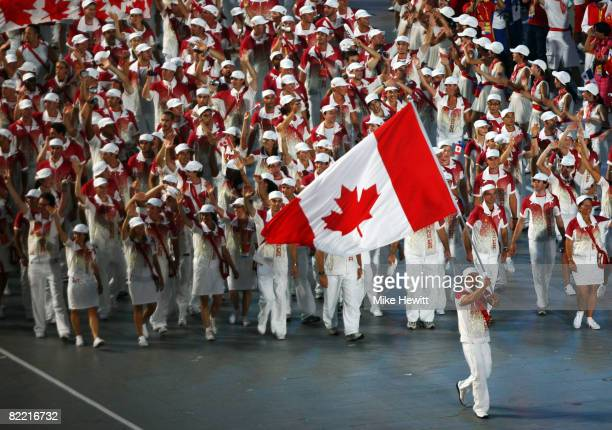 Canoe/Kayak athlete Adam Van Koeverden of Canada carries his teams flag during the Opening Ceremony for the 2008 Beijing Summer Olympics at the...