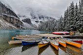 Canoes at dock Moraine Lake Summer time snows