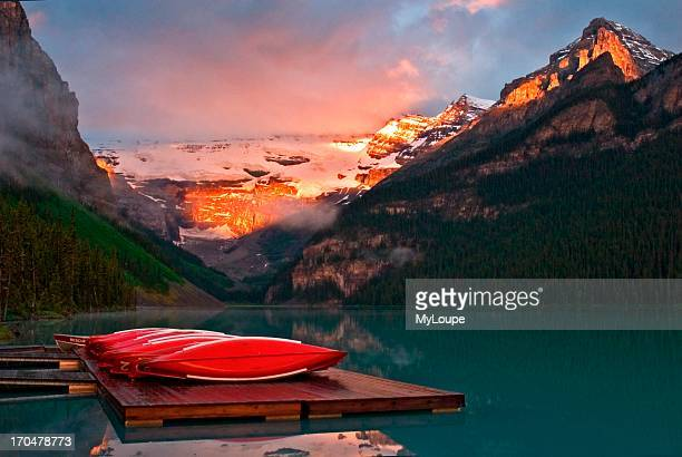 Canoes at the dock on Lake Louise in Banff National Park in Alberta Canada