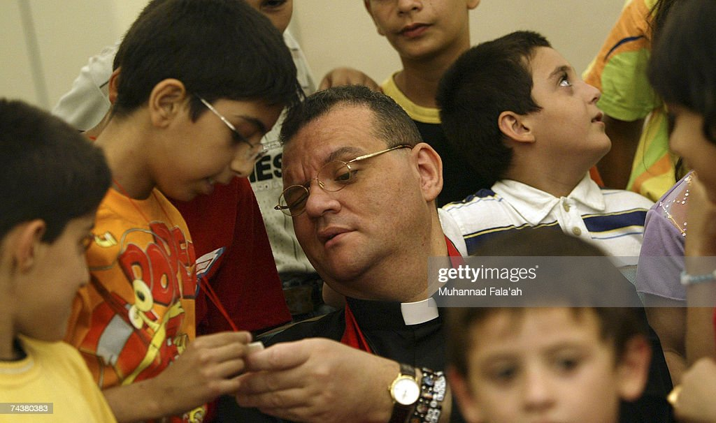 Canon Andrew White the vicar of Baghdad St George's church talks to Iraqi Christian children as he holds a service for the release of five British...