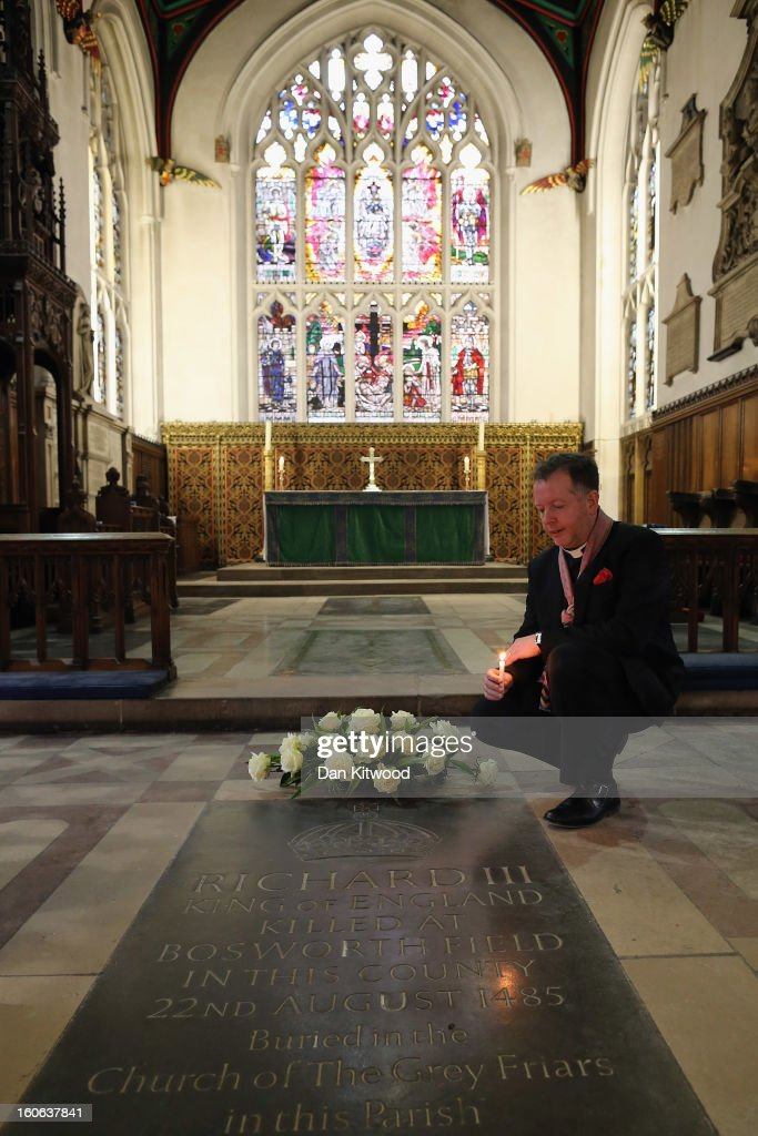 Canon Chancellor of Leicester Cathedral, David Monteith kneels next to a memorial stone marking the death of King Richard III inside Leicester Catherdral, close to where the body of Richard III was discovered, on February 4, 2013 in Leicester, England. The University of Leicester has been carrying out scientific investigations on remains found in a car park to find out whether they are those of King Richard III since last September, when the skeleton was discovered in the foundations of Greyfriars Church, Leicester. King's Richard III's remains are to be re-interred at Leicester Catherdral.