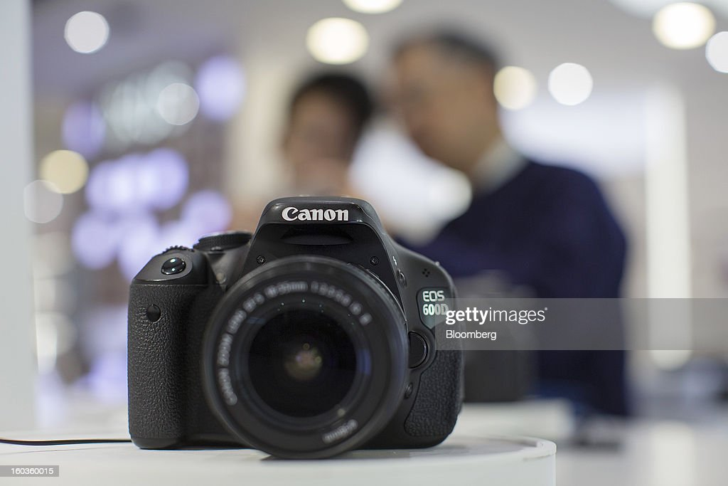 A Canon Inc. EOS 600D digital single lens reflex (SLR) camera, known as the EOS Kiss X5 in Japan and the EOS Rebel T3i in the Americas, sits on display at the company's showroom in Hong Kong, China, on Tuesday, Jan. 29, 2013. Canon, the world's largest camera maker, forecast profit will rise 14 percent this year amid a weaker yen and the withering of a boycott of Japanese goods in China. Photographer: Jerome Favre/Bloomberg via Getty Images