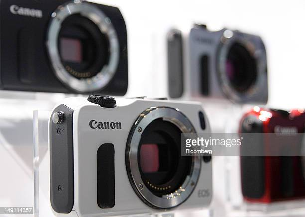 Canon Inc EOS M mirrorless interchangeablelens cameras are displayed at its unveiling in Tokyo Japan on Monday July 23 2012 Canon Inc the world's...