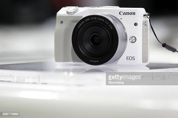 A Canon Inc EOS M3 mirrorless digital camera sits on display at the company's showroom in Tokyo Japan on Monday Jan 25 2016 The Japanese office...