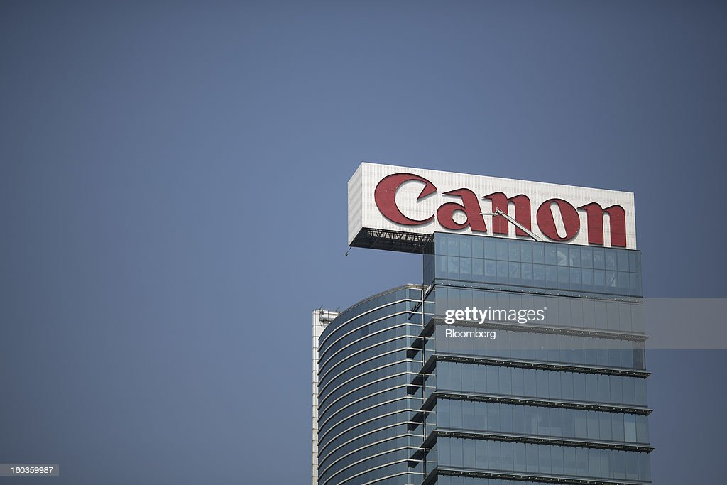 Canon Inc. signage is displayed on top of a building in Hong Kong, China, on Tuesday, Jan. 29, 2013. Canon, the world's largest camera maker, forecast profit will rise 14 percent this year amid a weaker yen and the withering of a boycott of Japanese goods in China. Photographer: Jerome Favre/Bloomberg via Getty Images
