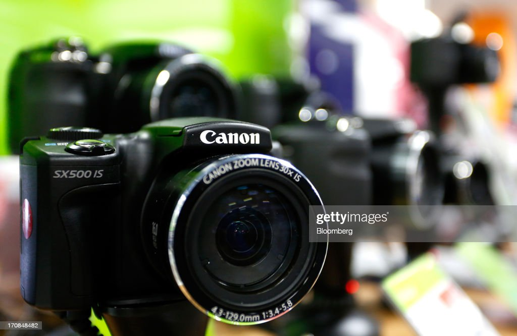 A Canon Inc. SX500 IS digital camera is displayed for sale inside a Currys and PC World 2 in 1 store, operated by Dixons Retail Plc, in Manchester, U.K., on Tuesday, June 18, 2013. Dixons Retail Plc, the U.K.'s largest consumer-electronics retailer, said last month it will report annual pretax profit at the 'top end' of analysts' predictions after fourth-quarter revenue beat estimates on increased sales of tablets and services such as software tutorials. Photographer: Paul Thomas/Bloomberg via Getty Images