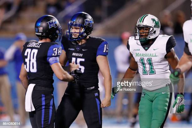 Canon Rooker of the Middle Tennessee Blue Raiders celebrates with Jim Cardwell after kicking a 50yard field goal in the first quarter of a game...