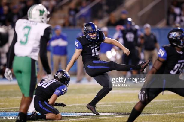 Canon Rooker of the Middle Tennessee Blue Raiders kicks a 50yard field goal in the first quarter of a game against the Marshall Thundering Herd at...