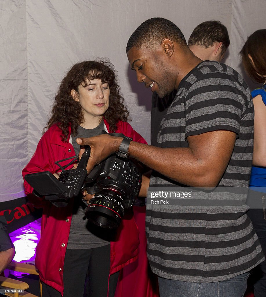 Canon's Cindy Baer helps a guest at the Canon Celebrates Storytellers event - 2013 Los Angeles Film Festival held at the L.A. Live Event Deck on June 15, 2013 in Los Angeles, California.