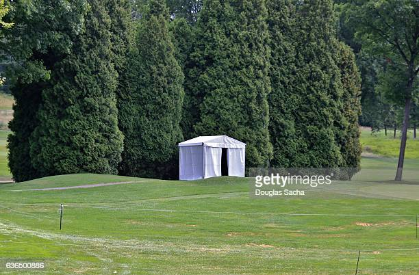 Canopy covered Porta potty in a open field