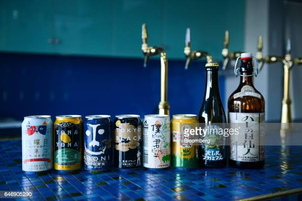 Cans and growlers of YoHo Brewing Co brand beers sit on display at the company's brewery in Saku Nagano Prefecture Japan on Friday Jan 6 2017 Craft...