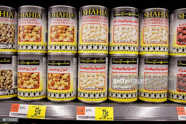 Cans labeled in English and Arabic sit on the shelves of the Middle Eastern foods aisle at a new multilingual WalMart that will stock the largest...