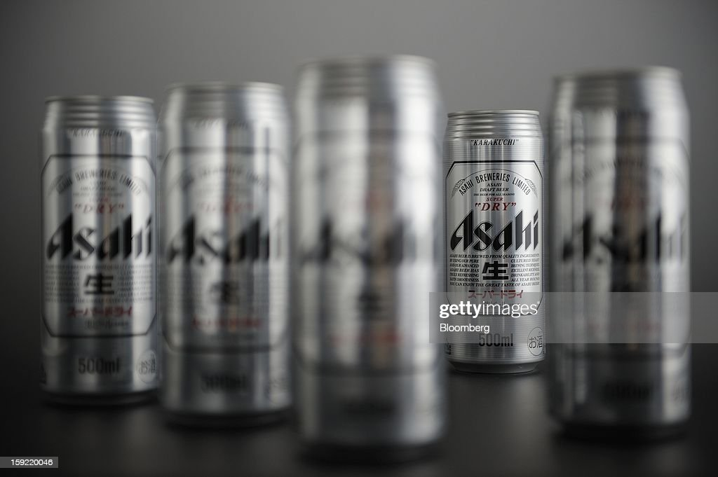 Cans of Asahi Breweries Ltd. Asahi Super Dry beer are arranged for a photograph in Kawasaki, Kanagawa Prefecture, Japan, on Wednesday, Jan. 9, 2013. Suntory, Kirin Holdings Co. and Asahi Group Holdings Ltd., have sought growth overseas as a declining population damps domestic demand. Photographer: Akio Kon/Bloomberg via Getty Images