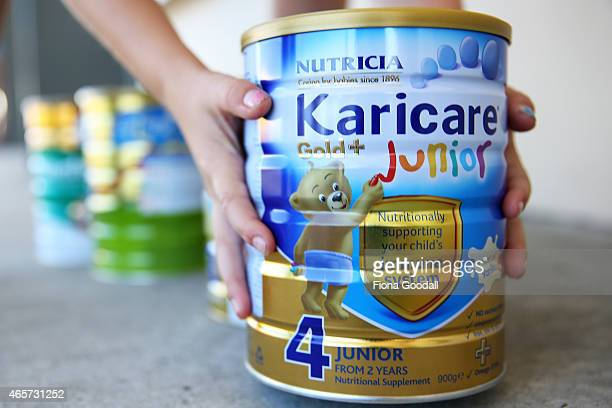 Cans of baby formula are seen on March 10 2015 in Auckland New Zealand Fonterra and Federated Farmers received anonymous letters in November last...