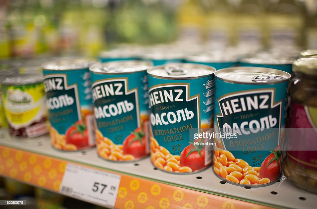 Cans of baked beans, produced by U.S. manufacturer HJ Heinz Co., sit on a shelf inside a Dixy supermarket operated by OAO Dixy Group in Moscow, Russia, on Tuesday, April 8, 2014. Suppliers suffering from ruble depreciation this quarter are urging retailers to increase prices. Photographer: Andrey Rudakov/Bloomberg via Getty Images