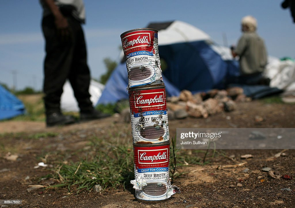 Cans of beef broth are stacked at a homeless tent city April 13 2009 in Sacramento California Hundreds of residents living in a tent city along the...