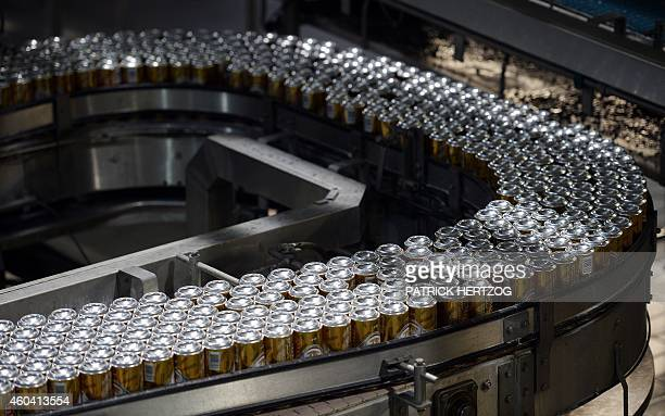 Cans of beer are seen on the Kronenbourg brewer production line on December 12 2014 at the main factory in the eastern French city of Obernai AFP...