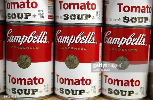 Cans of Campbell's tomato soup are displayed on a shelf at Santa Venetia Market on May 20 2013 in San Rafael California Campbell Soup Co reported a...