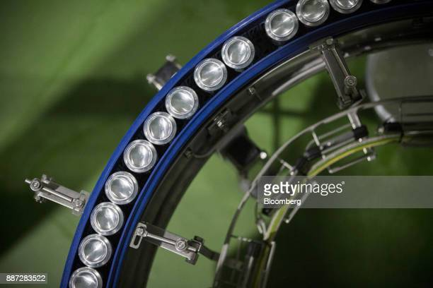Cans of Carabao energy drink move along a conveyor on the production line at the Carabao Group Pcl plant in Chachoengsao Chachoengsao Province...