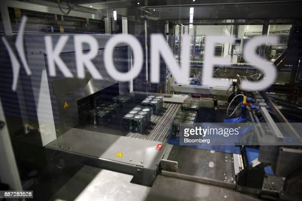 Cans of Carabao energy drink move through a Kronos SA canning machine on the production line at the Carabao Group Pcl plant in Chachoengsao...