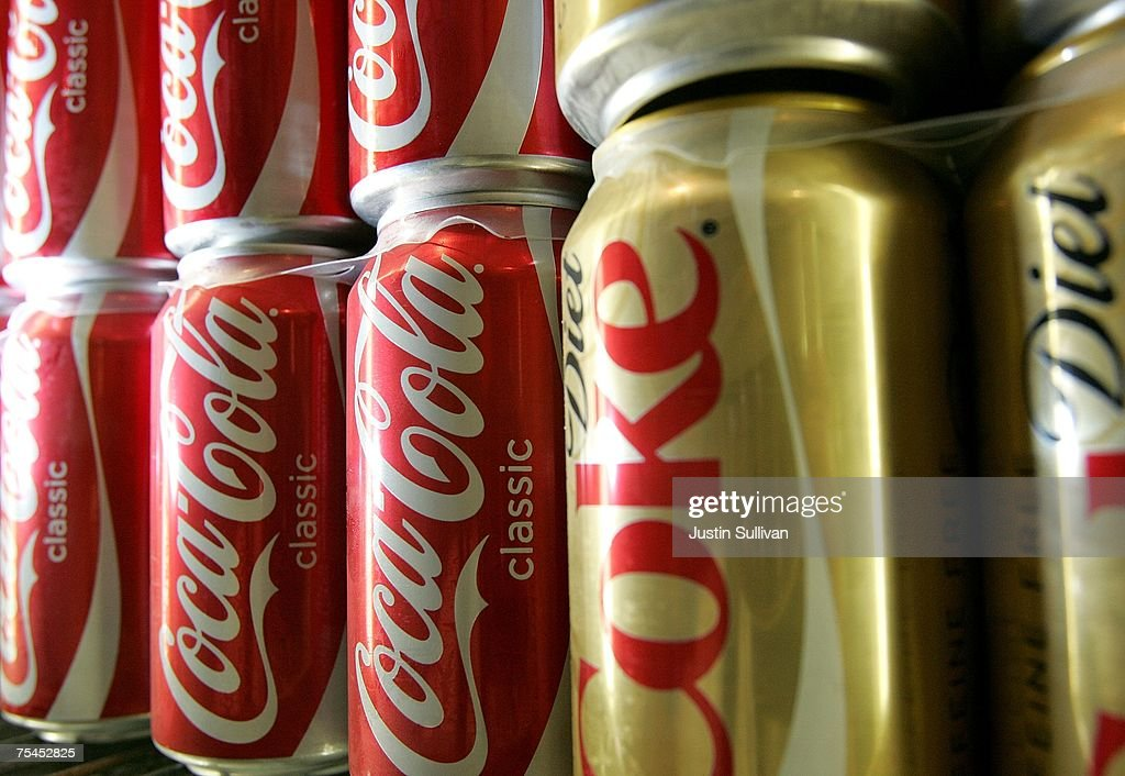 Cans of Coca Cola are seen on a shelf at the Mayflower Market July 17 2007 in San Francisco California Coca Cola Company reported an increase in...