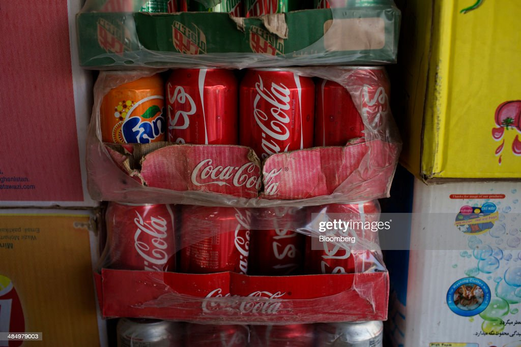 Cans of Coca-Cola Co. beverage are displayed for sale at a merchant's store in Kabul, Afghanistan, on Thursday, April 10, 2014. Coca-Cola Co., the world's largest soda maker, today showed signs of a rebound in the first three months of the year, easing the concerns that arose when the company unsettled investors with surprisingly sluggish global sales in the fourth quarter. Photographer: Victor J. Blue/Bloomberg via Getty Images
