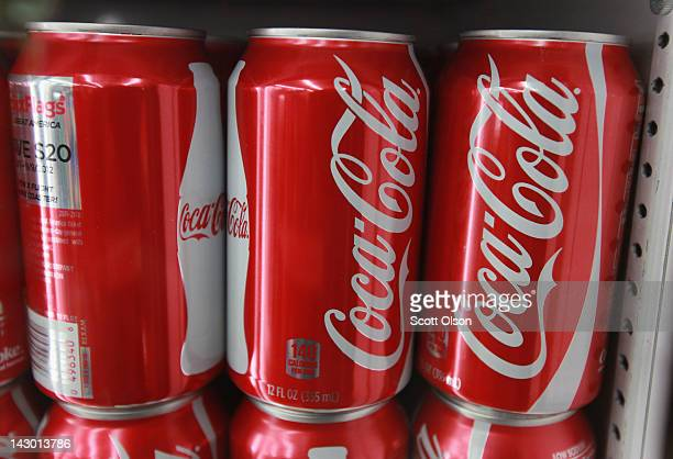 Cans of CocaCola soda are offered for sale at a grocery store on April 17 2012 in Chicago Illinois The CocaCola Co reported an 8 percent increase in...