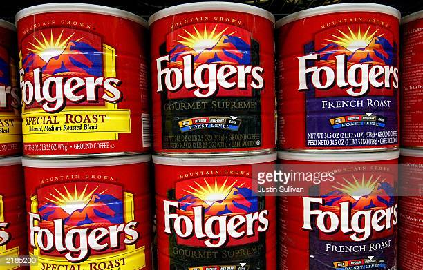 Cans of Folgers Coffee are seen on the shelf at Andronico's Market July 22 2003 in Palo Alto California In a cost cutting measure Folgers the...