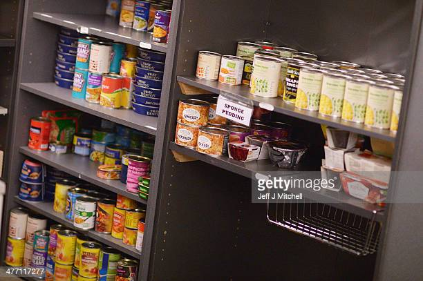 Cans of food are stacked on the shelves at a food bank on March 7 2014 in Whitburn Scotland Charities based in Scotland are reporting that many...