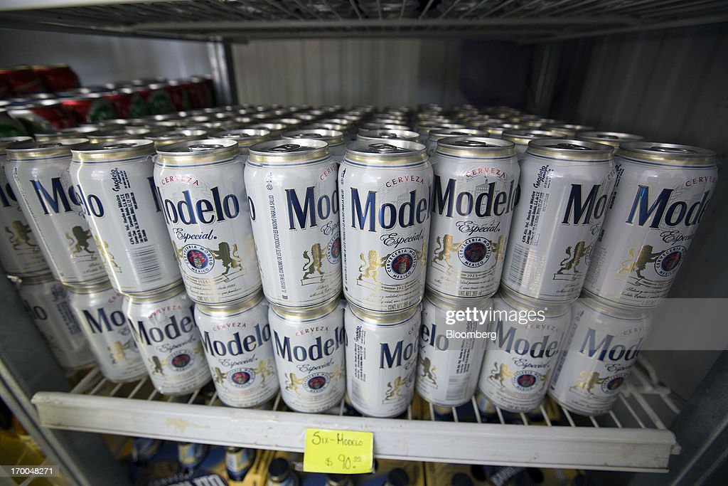 Cans of Grupo Modelo SAB beer sit in a cooler in a store in Mexico City, Mexico, on Thursday, June 6, 2013. Heineken NV and Grupo Modelo SAB, the dominant brewers in Mexico with brands such as Dos Equis and Corona, are nearing the end of an almost three-year-old government antitrust probe. Photographer: Susana Gonzalez/Bloomberg via Getty Images