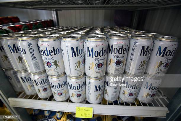 Cans of Grupo Modelo SAB beer sit in a cooler in a store in Mexico City Mexico on Thursday June 6 2013 Heineken NV and Grupo Modelo SAB the dominant...