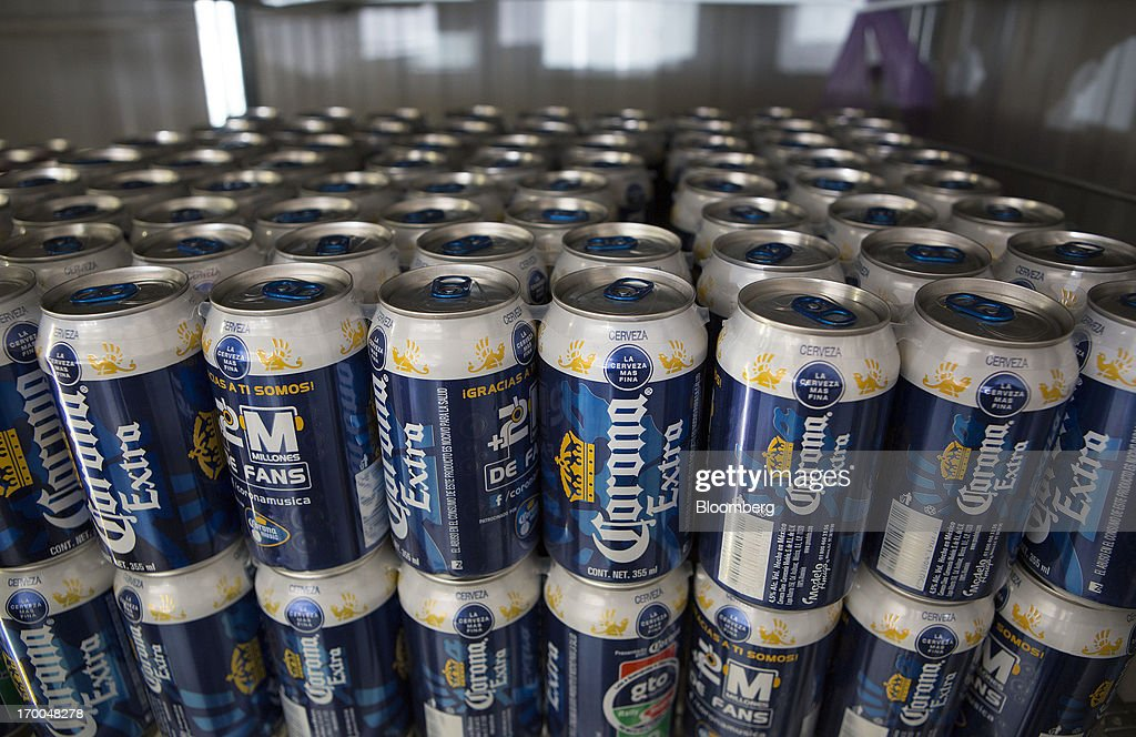 Cans of Grupo Modelo SAB's Corona Extra sit in a store in Mexico City, Mexico, on Thursday, June 6, 2013. Heineken NV and Grupo Modelo SAB, the dominant brewers in Mexico with brands such as Dos Equis and Corona, are nearing the end of an almost three-year-old government antitrust probe. Photographer: Susana Gonzalez/Bloomberg via Getty Images