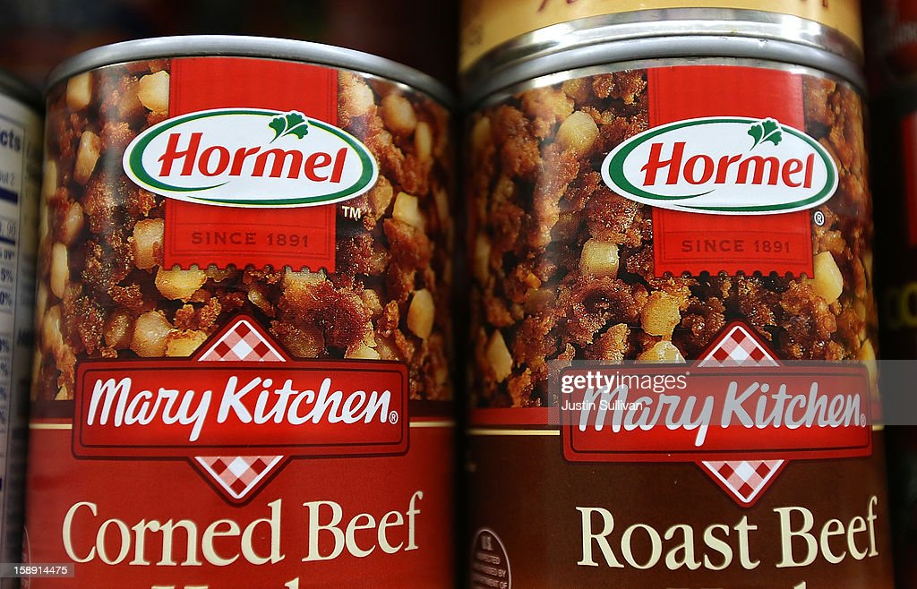 Cans of Hormel meats are displayed on a shelf at Cal Mart grocery store on January 3, 2013 in San Francisco, California. Hormel, the maker of Spam, announced that it will purchase the Skippy peanut butter brand from Unilever for $700 million in cash.