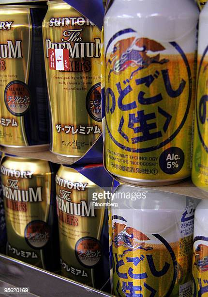 Cans of Kirin Brewery Co right and Suntory Ltd beer are displayed for sale at a liquor shop in Tokyo Japan on Wednesday Jan 6 2010 Kirin Holdings Co...