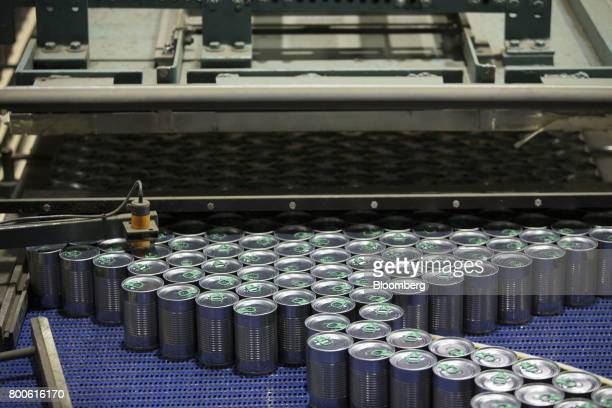 Cans of peas and carrots move along a conveyor at the Del Monte Foods Inc facility in Mendota Illinois US on Friday June 23 2017 The facility...