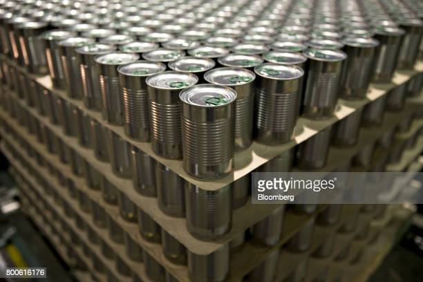 Cans of peas and carrots sit stacked on a pallet at the Del Monte Foods Inc facility in Mendota Illinois US on Friday June 23 2017 The facility...