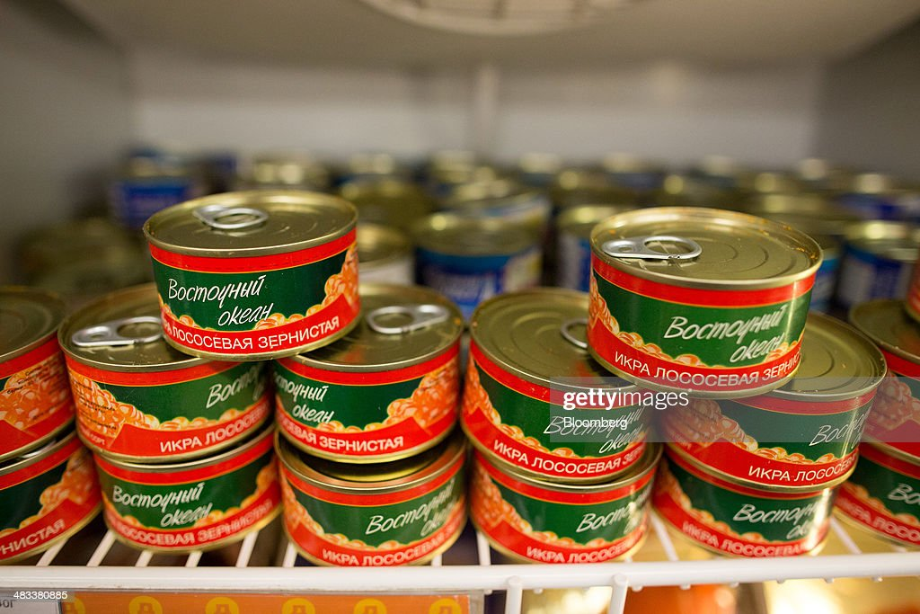 Cans of red caviar sit in a refrigerator inside a Dixy supermarket operated by OAO Dixy Group in Moscow, Russia, on Tuesday, April 8, 2014. Suppliers suffering from ruble depreciation this quarter are urging retailers to increase prices. Photographer: Andrey Rudakov/Bloomberg via Getty Images