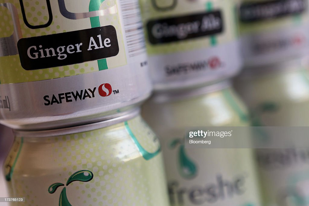 Cans of Safeway Inc. ginger ale soda are arranged for a photograph in Torrance, California, U.S., on Tuesday, July 16, 2013. Safeway Inc. is scheduled to release earnings figures on July 18. Photographer: Patrick T. Fallon/Bloomberg via Getty Images