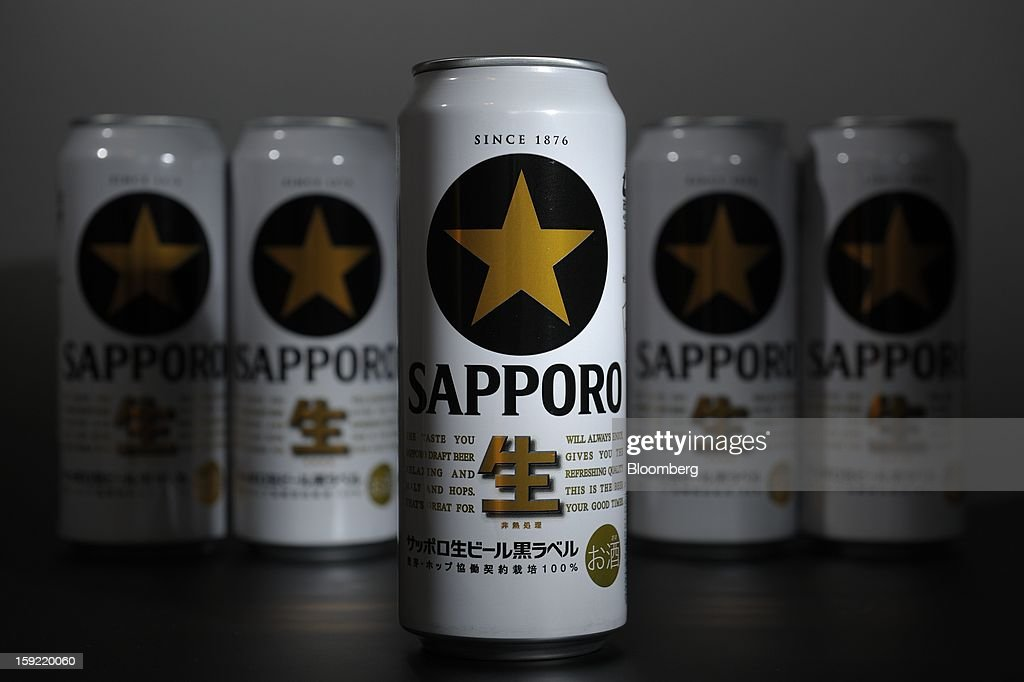 Cans of Sapporo Breweries Ltd. beer are arranged for a photograph in Kawasaki, Kanagawa Prefecture, Japan, on Wednesday, Jan. 9, 2013. Sapporo is Japan's fourth-largest brewer. Photographer: Akio Kon/Bloomberg via Getty Images