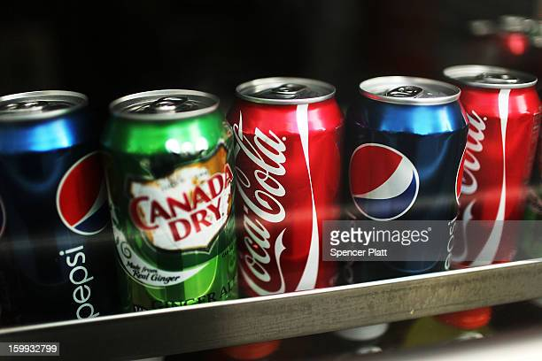 Cans of soda are displayed on a shelf on January 23 2013 in New York City As American consumers continue to shift to water coffee and other drinks...