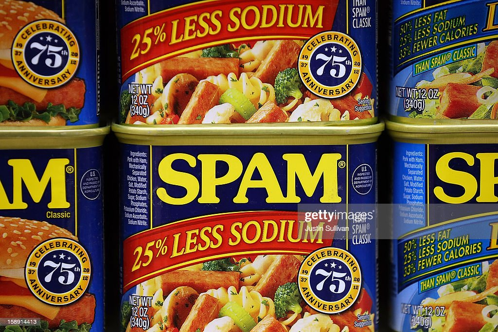 Cans of Spam are displayed on a shelf at Cal Mart grocery store on January 3, 2013 in San Francisco, California. Hormel, the maker of Spam, announced that it will purchase the Skippy peanut butter brand from Unilever for $700 million in cash.
