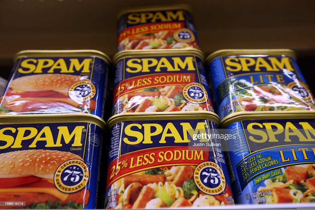 Cans of Spam are displayed on a shelf at Cal Mart grocery store on January 3, 2013 in San Francisco, California. Hormel, the maker of Spam, announced that it will purchase the Jiffy peanut butter brand from Unilever for $700 million in cash.